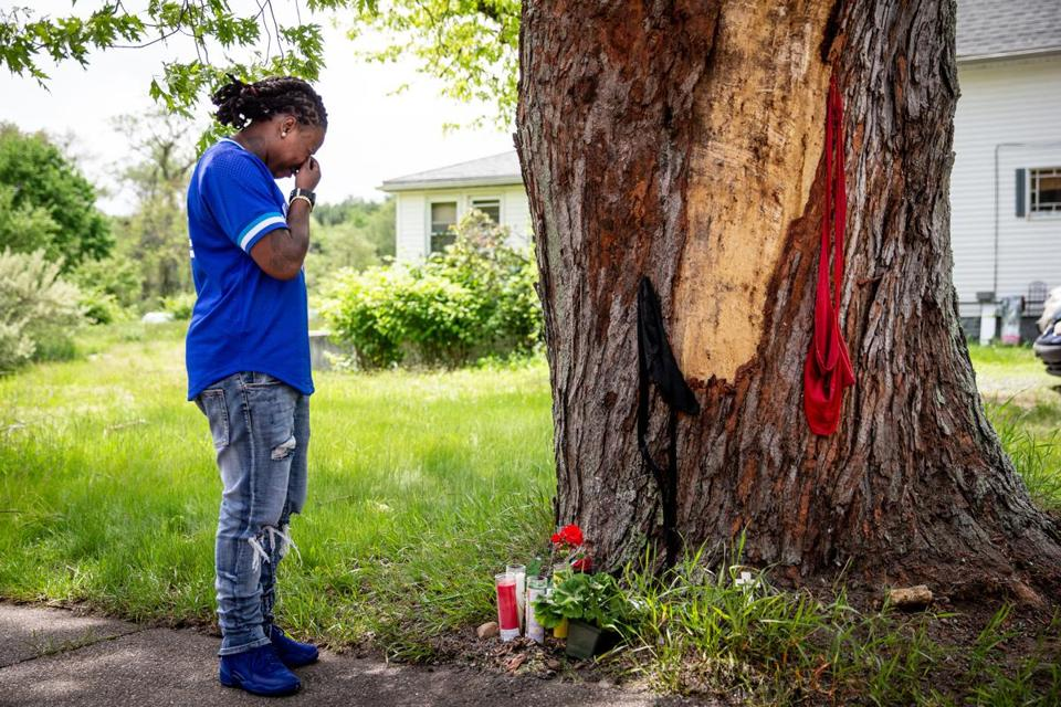 A woman became emotional while standing beside a tree at the site of the deadly car crash.